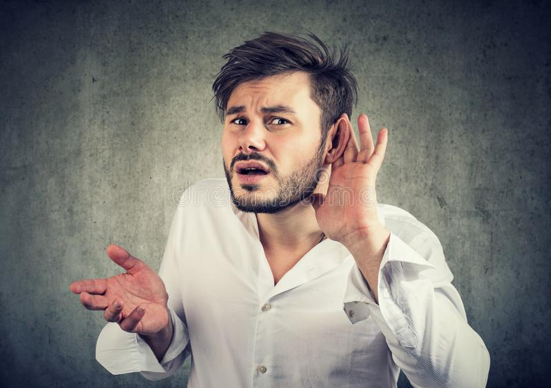 Deaf man in†confused with quiet sound royalty free stock photos