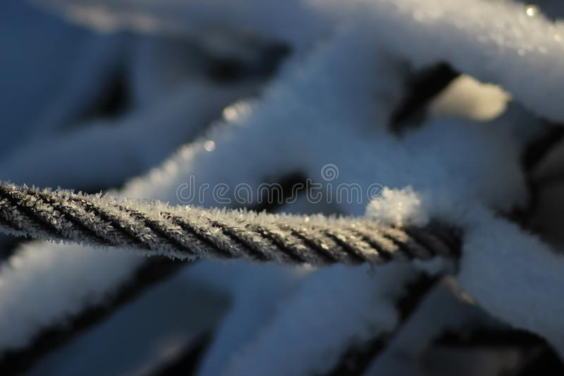 Frozen accounts as though the cable sturdy metal but still cool royalty free stock photography