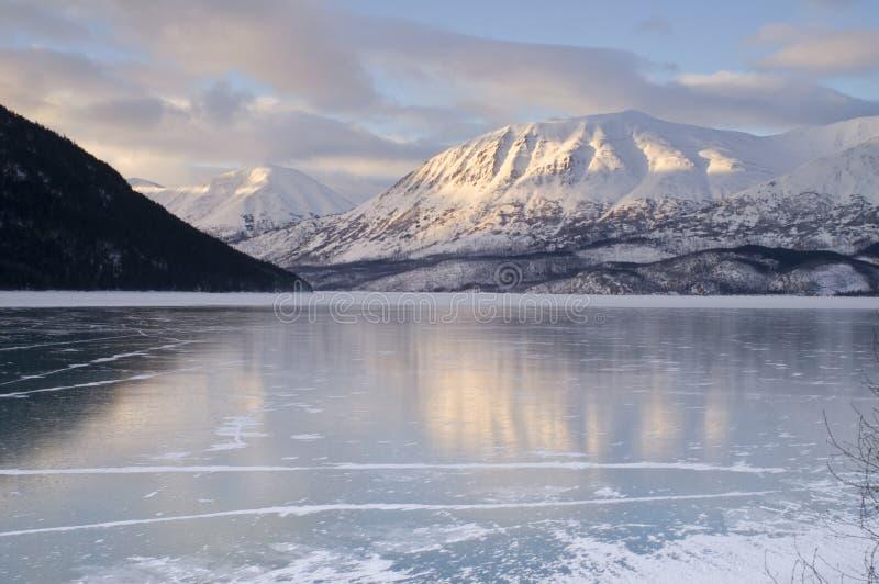 Frozen Kenai Lake Seward Hwy Alaska Wilderness. Kenai Lake Alaska frozen over during the winter stock photo