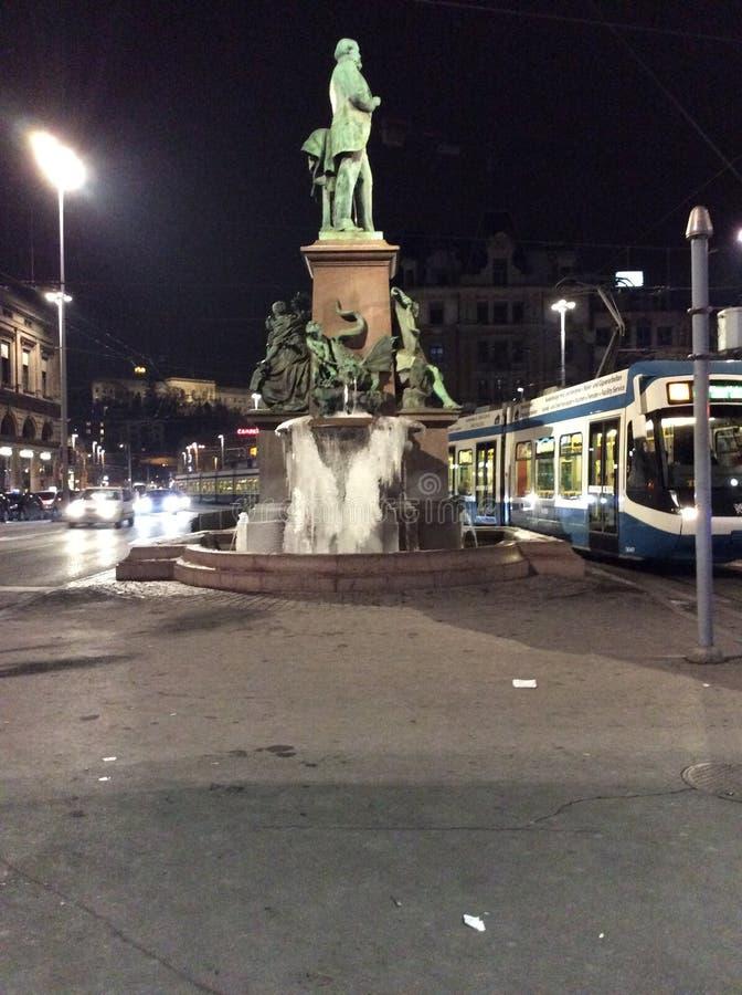 Frozen Alfred-Escher Fountain, Zurich near the Main Station, Switzerland stock images