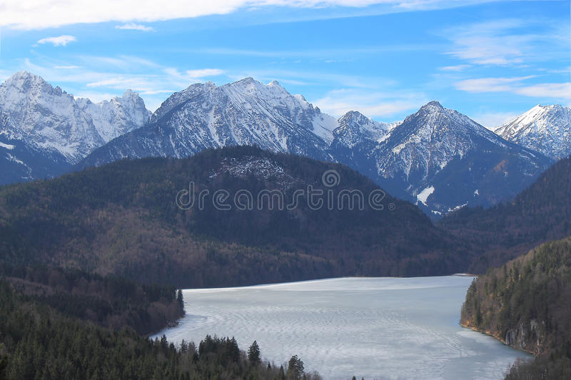 Frozen Alpsee lake royalty free stock photography