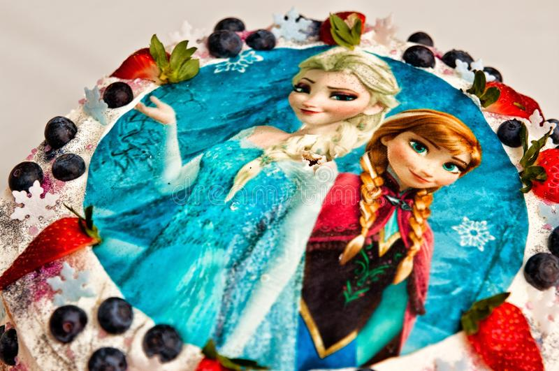 Frozen birthday cake. A birthday cake with Frozen movie characters topping picture of Anna and Elsa characters. Walt Disney blockbuster hit, popular among young royalty free stock photo