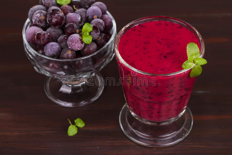 Frozen black currant berries smoothie with mint. stock photography