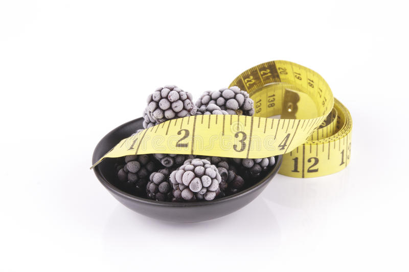 Frozen Blackberries In A Dish With Tape Measure Royalty Free Stock Photography