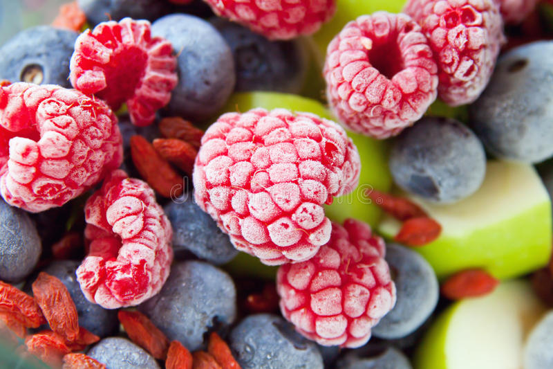Frozen blackberries fruits. With apple and goji stock image