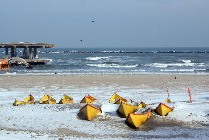 Frozen boats near the jetty royalty free stock photos