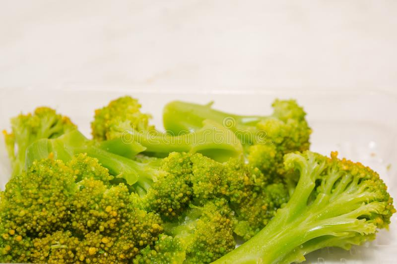 Frozen broccoli. Broccoli in the ice. Broccoli from the freezer. Frozen salad stock photo