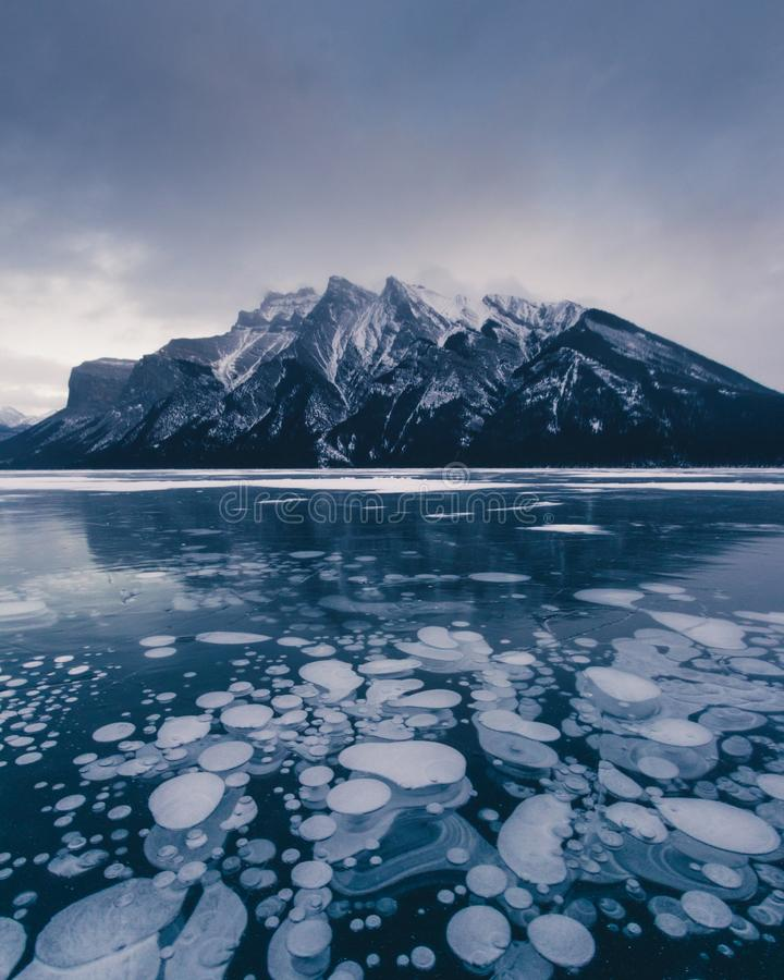 Winter Lake Minnewanka, Abraham, Methane bubbles,lifestyle, Travel Alberta, Canadian Rockies,Banff National Park,Icefiled Parkways. Frozen canadian lakes can stock photo