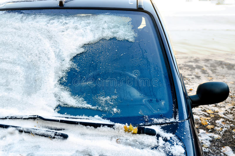 Frozen car. Close-up of snow-covered car windscreen royalty free stock photo