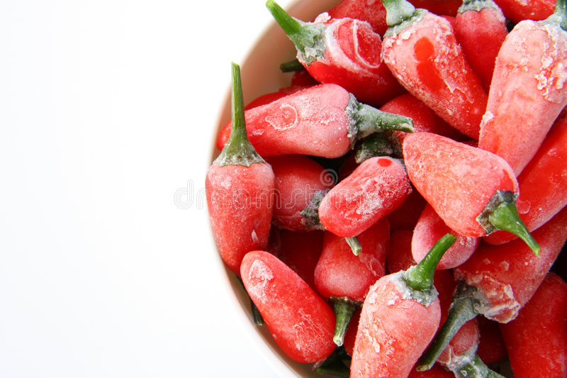 Frozen Chilis stock photos