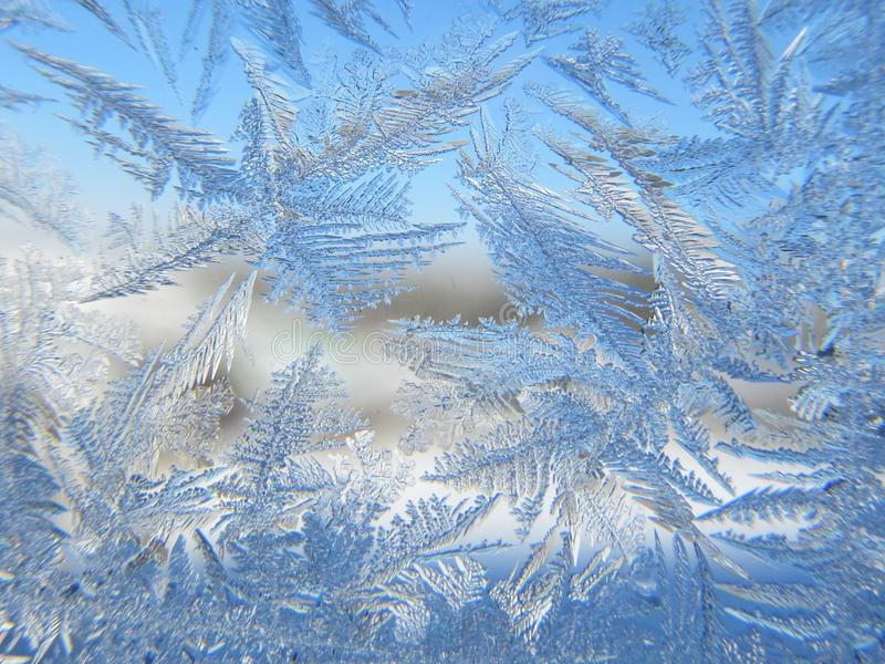 frozen decorative patterns on the window, stock photos