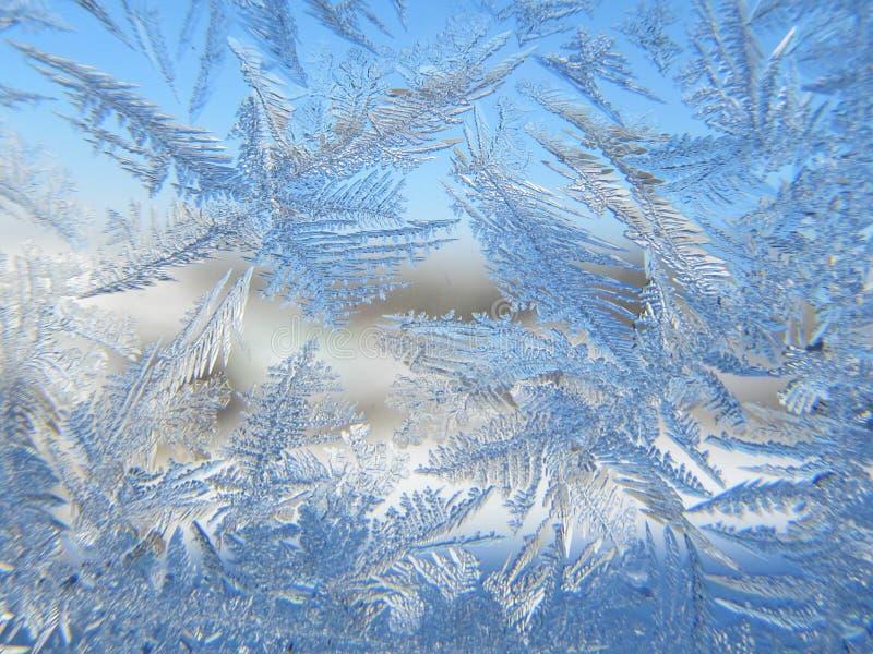 frozen decorative patterns on the window, stock photos