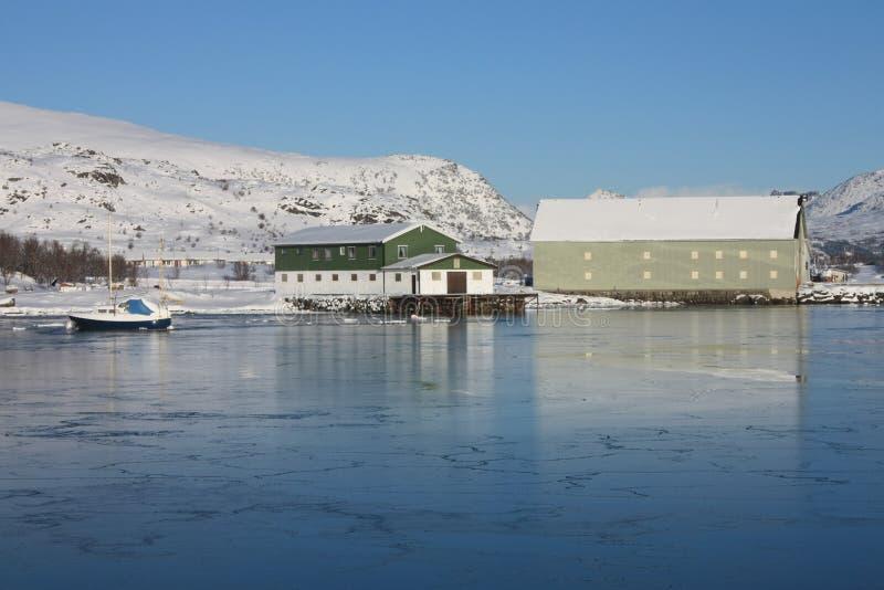 Frozen docks. Docks of the Busknes fjord frozen in wintertime royalty free stock photo