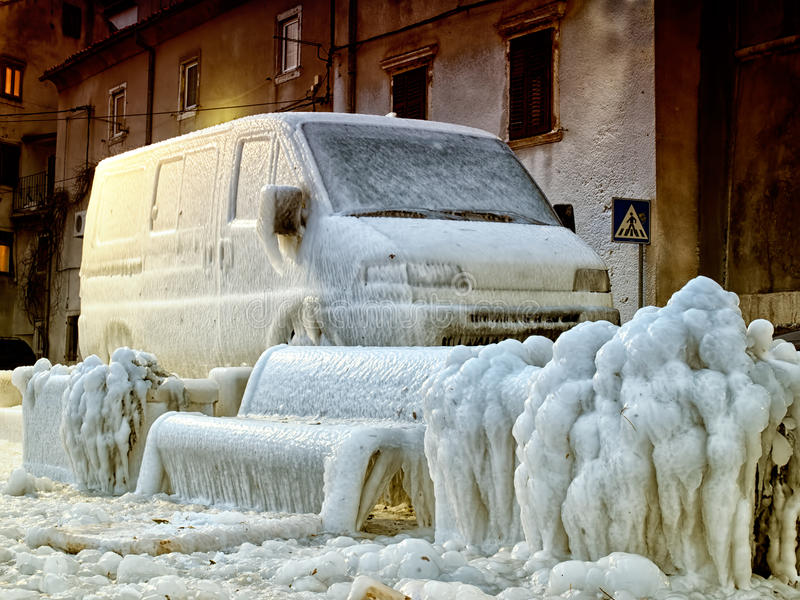 Frozen Europe. Icebound transport vehicle somewhere along the coast of the Adriatic Sea during winter 2012 stock images