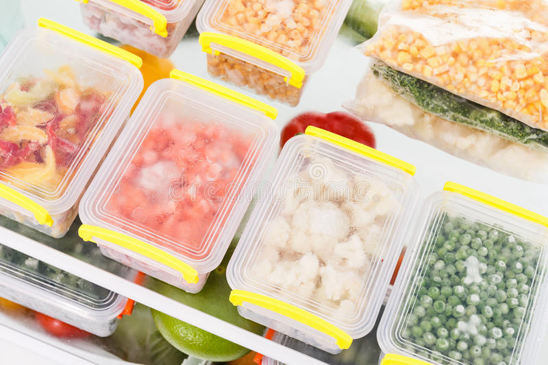 Frozen food in the refrigerator. Vegetables on the freezer shelves. Stocks of meal for the winter royalty free stock image