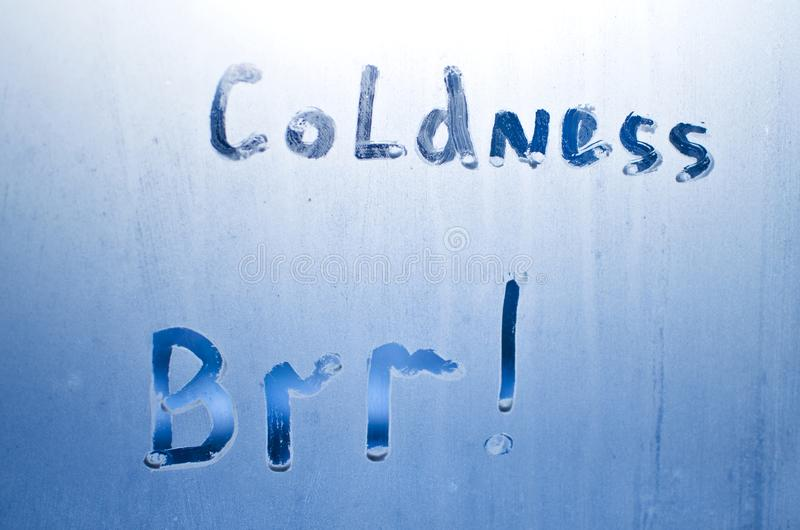 On a frozen glass it is written coldness brr royalty free stock image