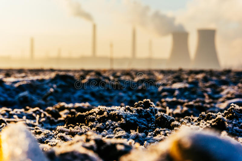 Frozen ground at oil refinery stock image