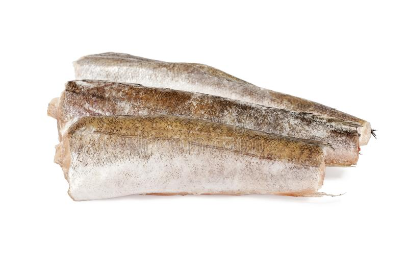 Frozen hake fish on white stock images