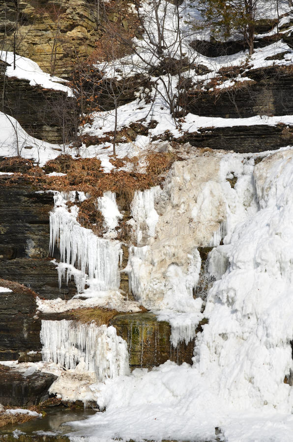 Frozen Hector Falls showing tiers of shale rock cut by glaciers royalty free stock photography