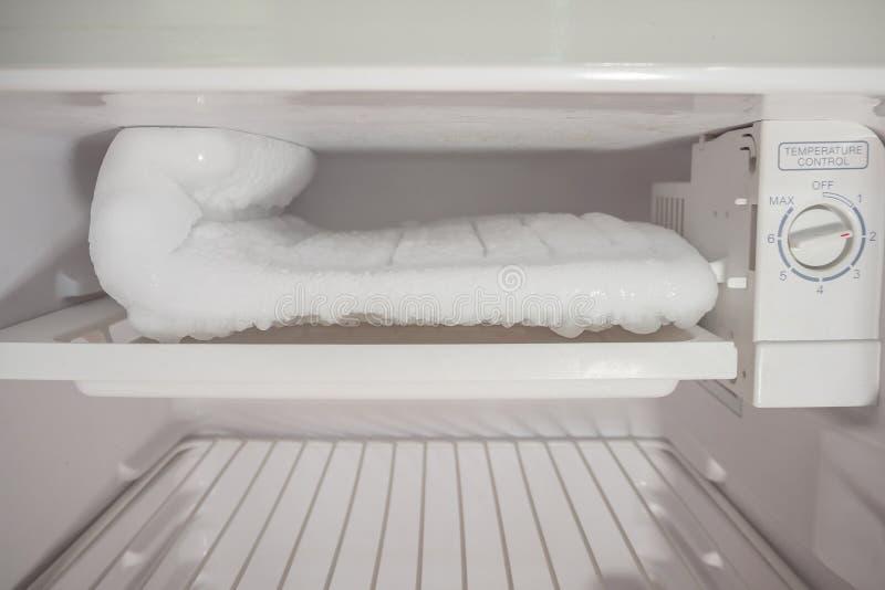 Frozen Ice buildup in the freezer stock photos
