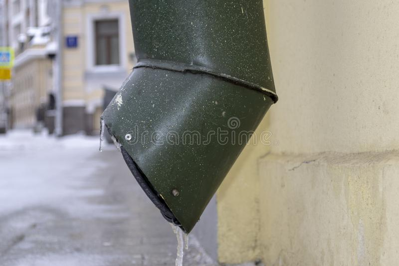 Frozen Icicle Hanging from Water Pipe. Frozen Icicle Hanging from Water Tin Pipe in Cold Winter Day royalty free stock photo