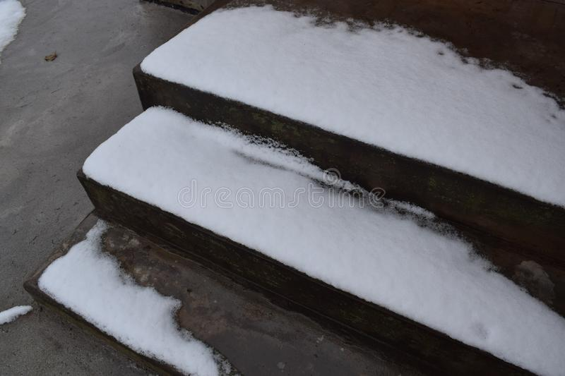 Frozen icy staircase in front of my country house. Frozen icy covered with November snow cement staircase in front of my country house in need to clean stock photo