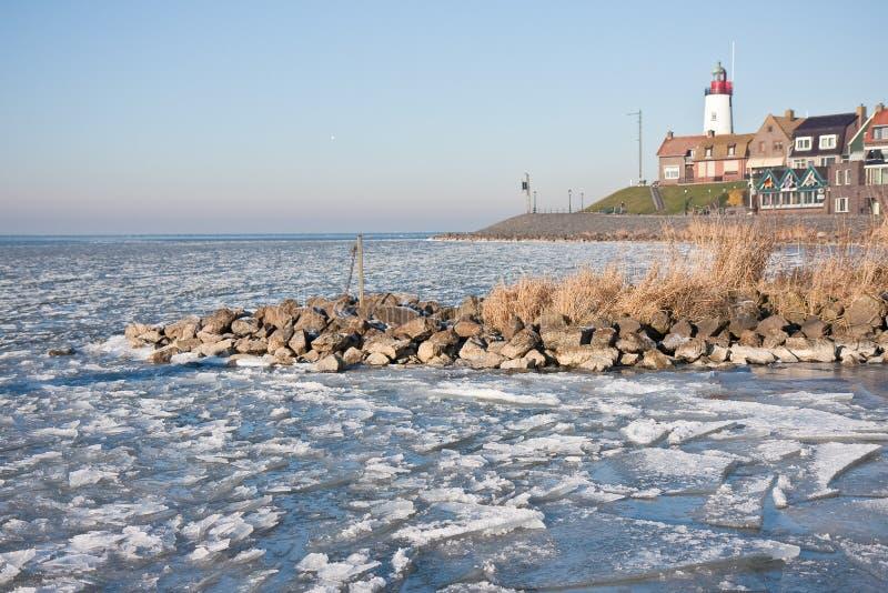 Frozen IJssellake in Holland. The Dutch village Urk and the frozen IJssellake royalty free stock images