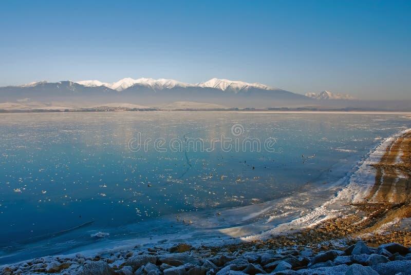 Frozen lake. Liptovska Mara with mountains on the horizon stock images