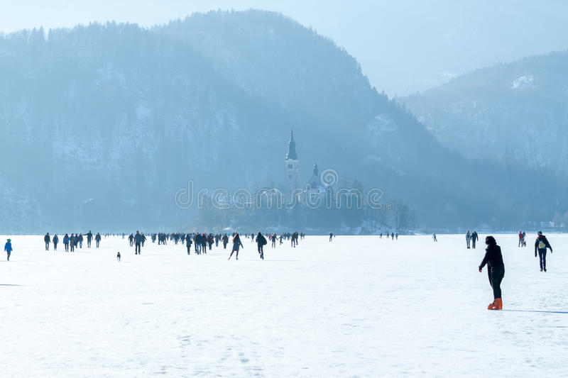 Frozen lake Bled many people on ice. Frozen lake Bled unique phenomenon many people on ice walking stock photos