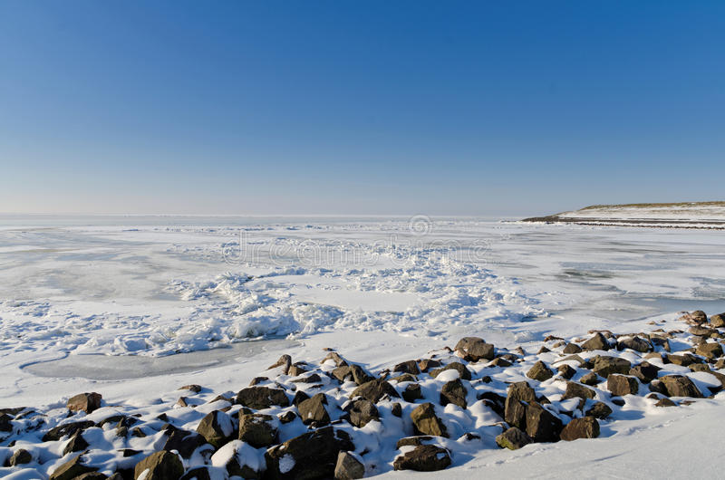 Download Frozen Lake With Crushed Ice Sheet And Rocks Stock Photo - Image: 25363070