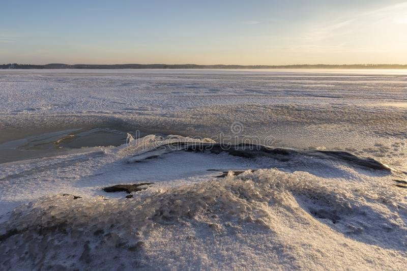 Frozen lake in Finland at morning royalty free stock photo