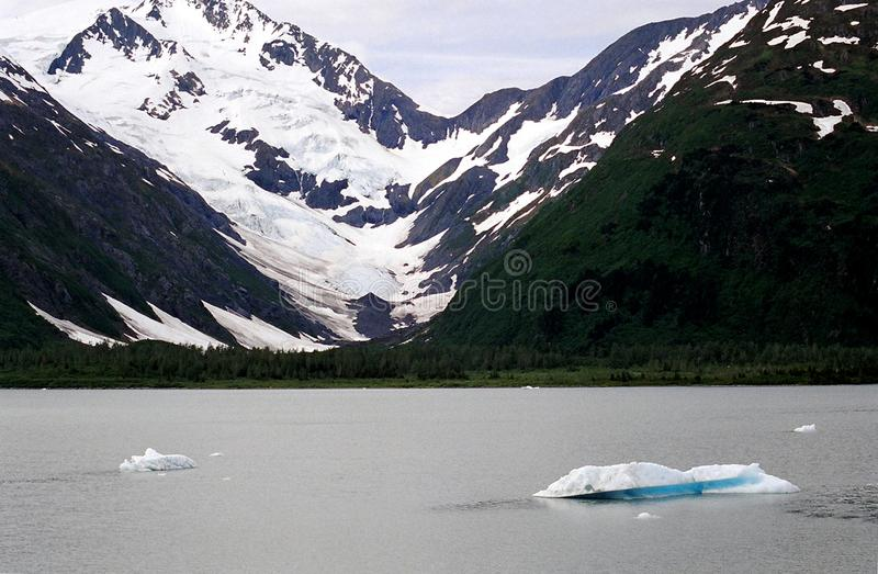 Alaska- A Frozen Lake With Snow Covered Mountains royalty free stock images