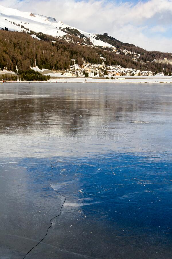 Frozen lake with ice crack on surface. With city at the background focus stacking royalty free stock photos