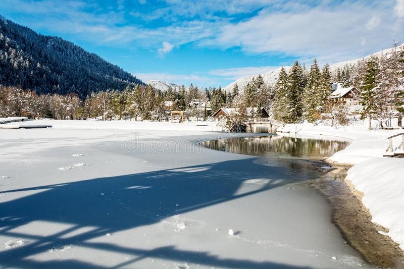 Frozen lake Jasna at Kranjska Gora and a view from tower. On a sunny winter day royalty free stock photography