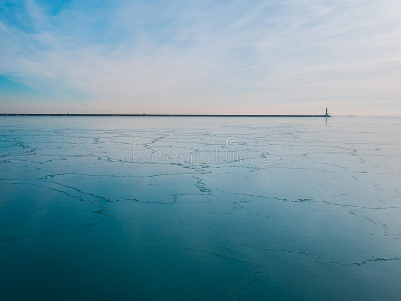 Frozen Lake with Lighthouse stock images