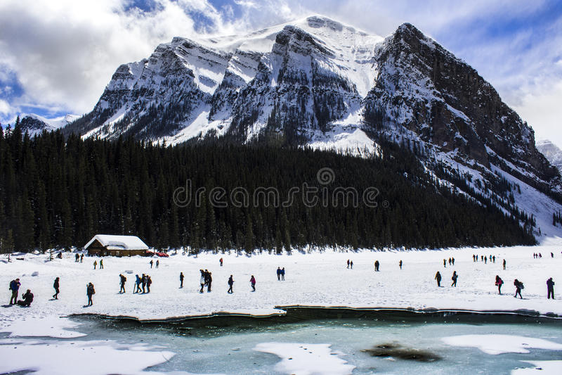 Frozen Lake Louise in Alberta, Canada on a Snowy Day. People playing on frozen Lake Louise in Alberta, Canada, on a snowy day royalty free stock photo
