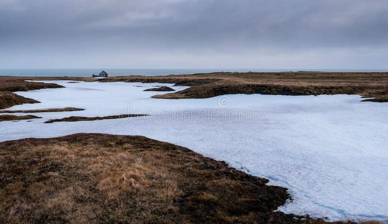 Frozen lake and meadow with snow Iceland royalty free stock image