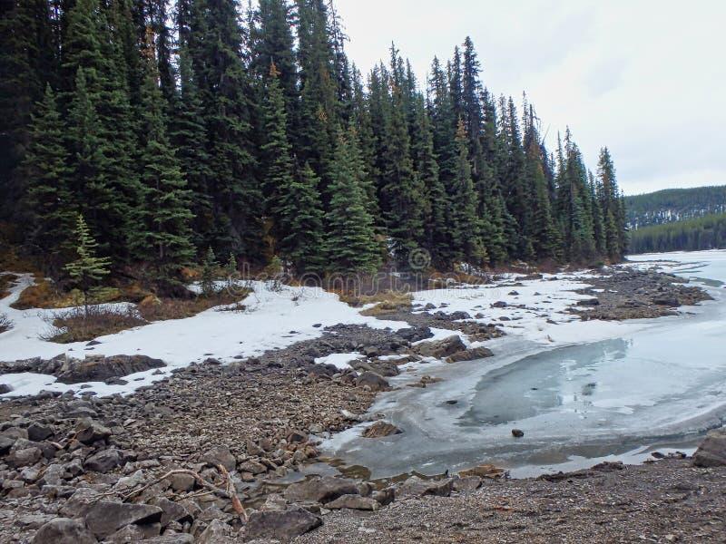 a frozen lake in the mountains stock photos