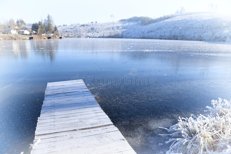 Download Frozen Lake And Pier With Rime Stock Photo - Image: 83708925