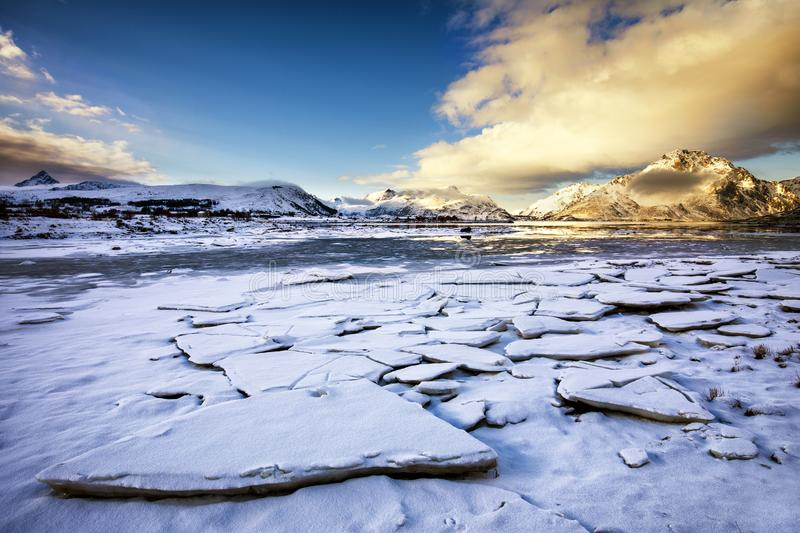 Frozen lake in the winter stock photo