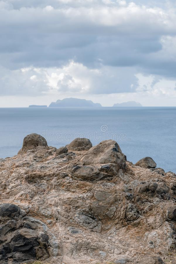 Madeira Islands landscape. Frozen lava structure on foreground with Madeira Islands archipelag on horizon stock photo