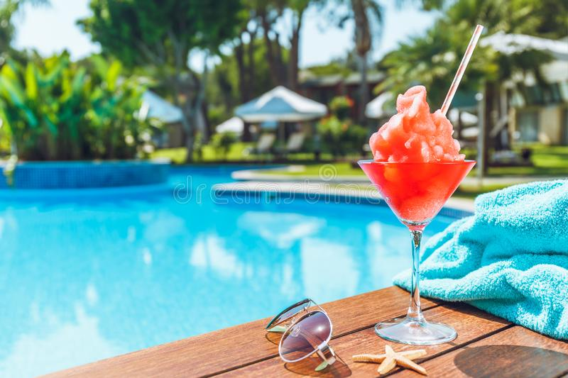 Frozen Margarita or Daiquiry cocktail near the pool. Vacation, summer, holiday, luxury resort concept. Coral shade drink stock photography