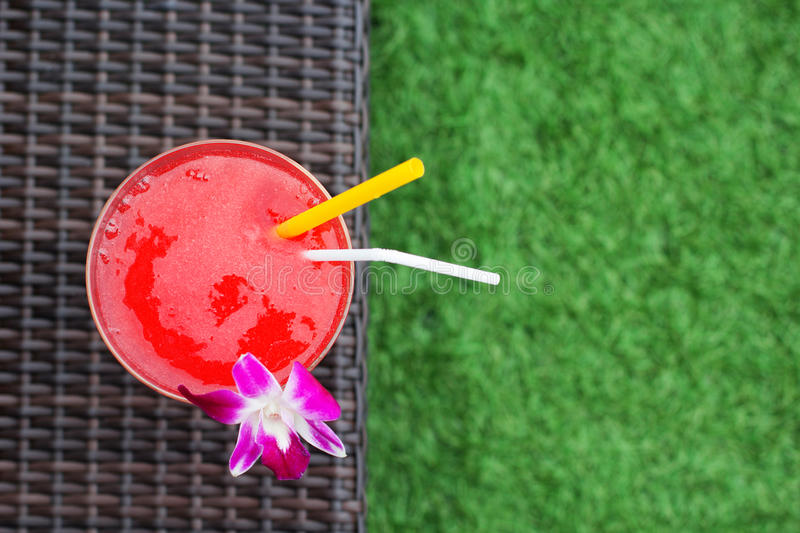 Frozen margarita with strawberry and orchid flower stock photo