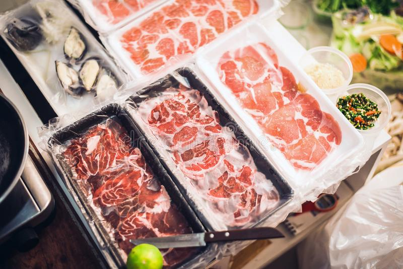 Frozen meat for consume in the foam tray,Raw material texture. Frozen meat for consume in the foam tray in kitchen,Raw material texture royalty free stock image