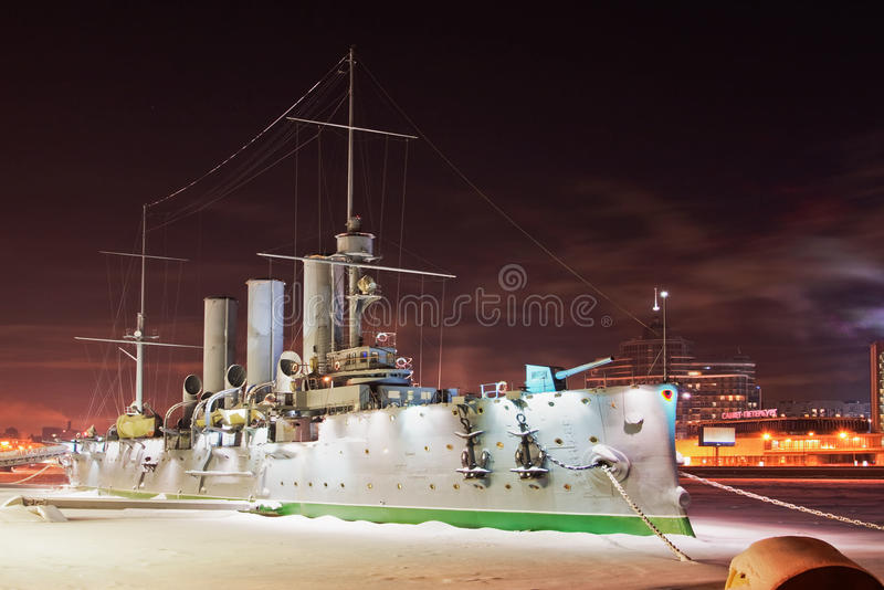Frozen military ship Avrora. Frozen hystorical monument of military ship Avrora in Russian Federation Saint-Petersburg (twiligh stock photos
