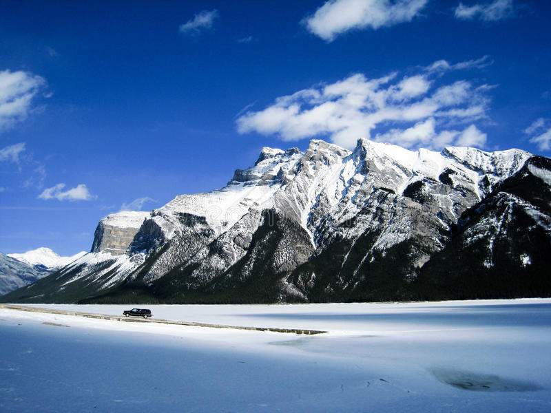 Frozen Minnewanka Lake of Banff National Park. One fine day at frozen Minnewanka Lake with blue sky in early spring royalty free stock photography