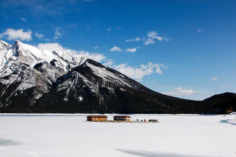 Frozen Minnewanka Lake of Banff National Park. One fine day at frozen Minnewanka Lake in early spring stock images