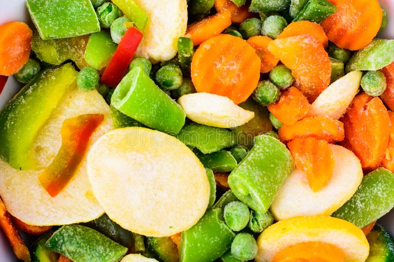 Frozen mix of vegetables with potatoes. Studio Photo royalty free stock photography