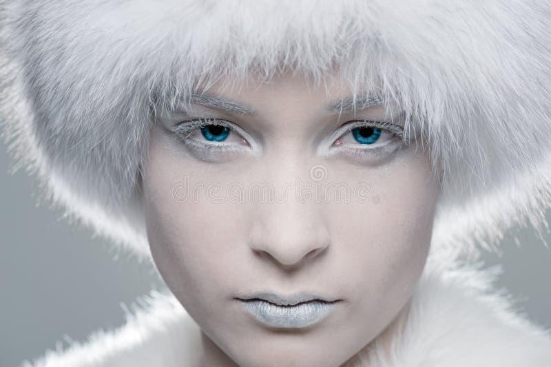 Frozen model in white fur stock image