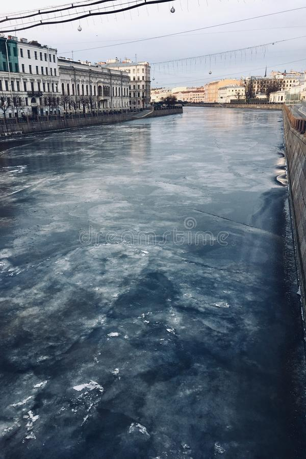 icy blue river on the background of a beautiful historic buildings. stock photography